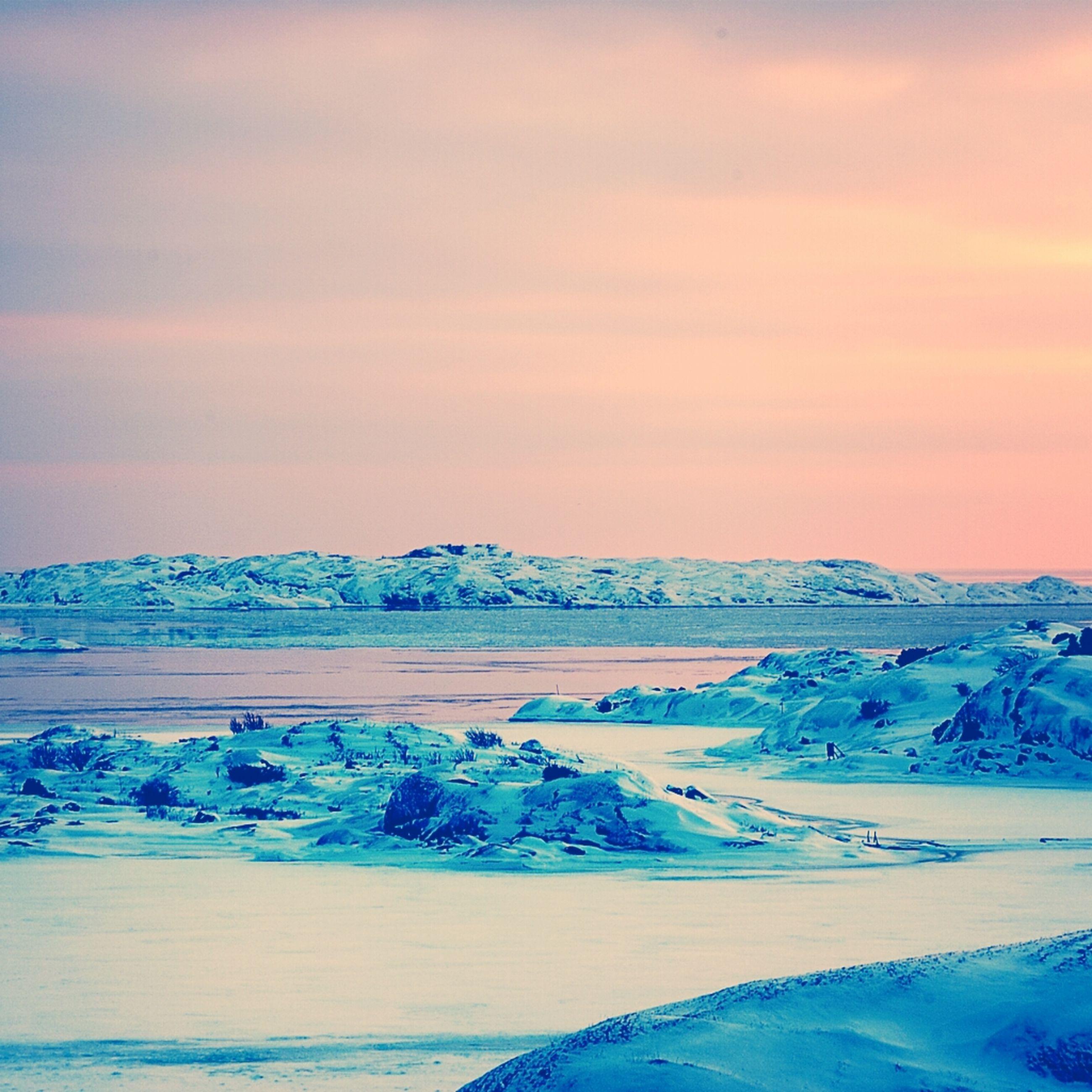 snow, cold temperature, winter, season, weather, beauty in nature, scenics, frozen, tranquil scene, tranquility, covering, sunset, sky, nature, idyllic, landscape, cloud - sky, blue, orange color, non-urban scene
