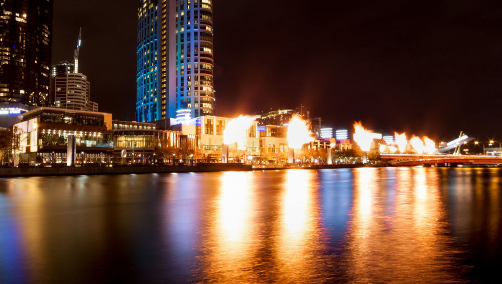 Crown Casino's Gas Brigades across the Yarra River City Life Cityscape Night Lights Architecture Building Exterior Built Structure City Cityscape Illuminated Night No People Outdoors Reflection Sky Skyscraper Tourist Destination Travel Destinations Urban Skyline Water Waterfront