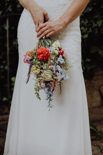 Woman holding wedding bouquet Bohemian Dress Engagement Love Natural Natural Light Nature Wedding Bouquet Wedding Photography Wedding Photography Writing Signature Woman Bouquet Close-up Day Flower Holding Human Body Part Human Hand People Photography Ring Of Kerry Vintage Wedding Day Wedding Photos Wedding Ring