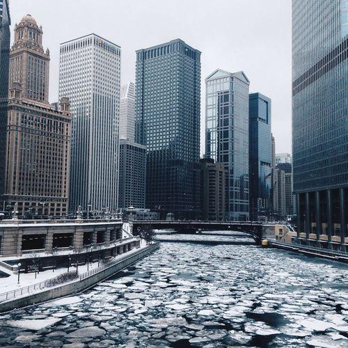 Frozen River By Skyscrapers