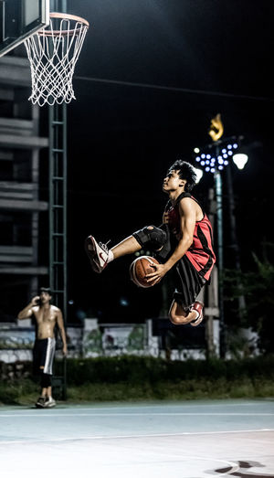 Basketball player jump for lay up in the air Action Active Ball Basketball Basketball Court Basketball Hoop Game Hoop Jump Jumping Lay Lifestyles Mid Air Night Outdoors Performance Person Player Portrait Sport Sports Photography Stopping Time Street Basket 🏀 Street Basketball Young Adult