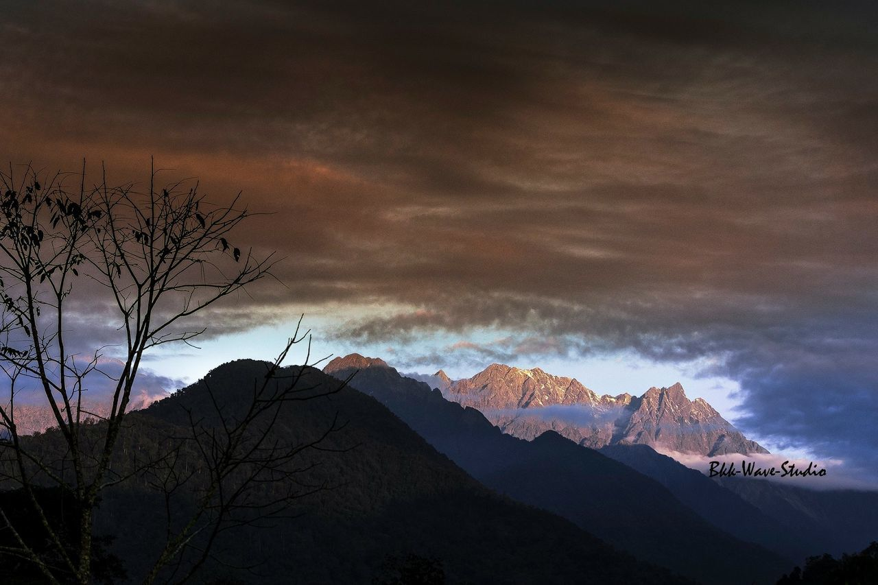 mountain, beauty in nature, sky, nature, scenics, tranquility, cloud - sky, silhouette, no people, tranquil scene, mountain range, outdoors, bare tree, winter, sunset, snow, day