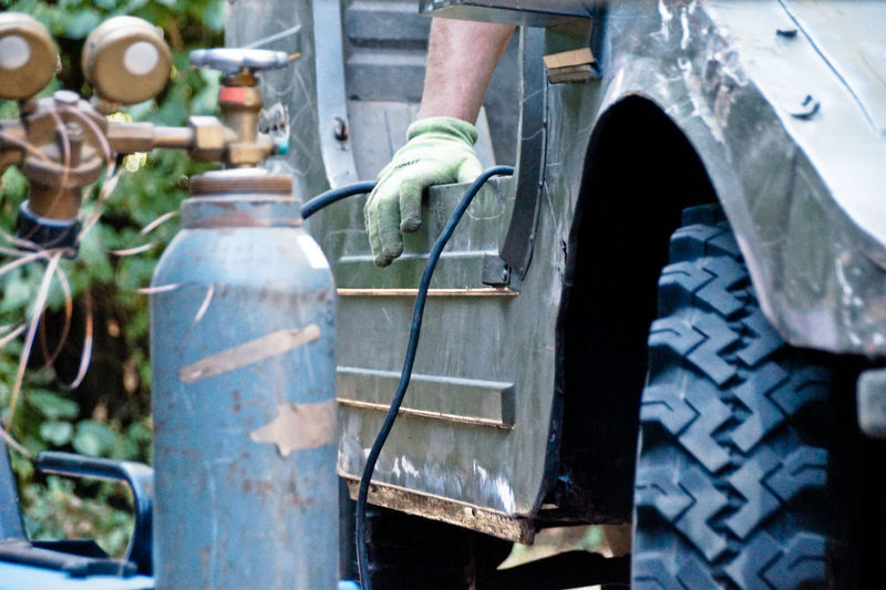 Cropped hand of male mechanic repairing vehicle
