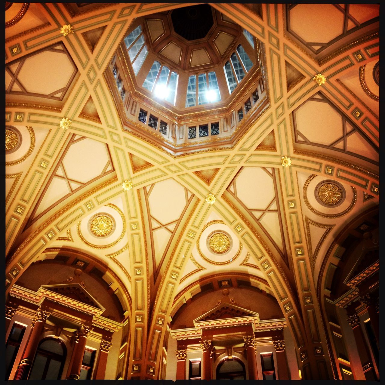 architecture, ceiling, low angle view, indoors, built structure, religion, place of worship, no people, day