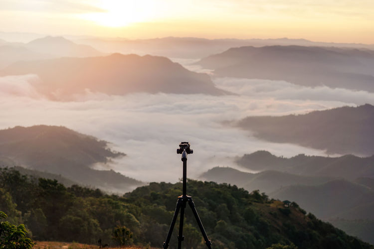 Focus on tripod in the beautiful view