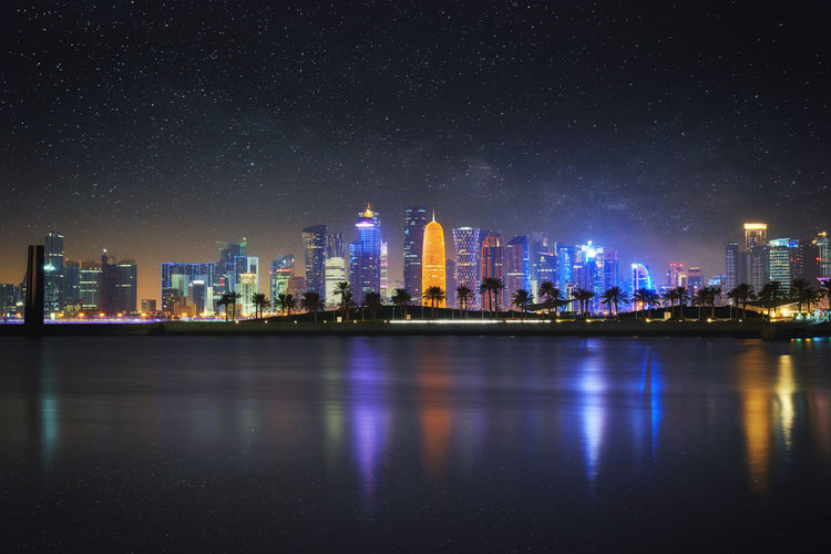 Doha's Westbay skyline seen from Museum of Islamic Art Park. Needless to say the stars were added. Doha Edited Reflection Westbay Architecture City Cityscape Illuminated Mia Night No People Outdoors Park Qatar Skyscraper Urban Skyline Water Waterfront HUAWEI Photo Award: After Dark