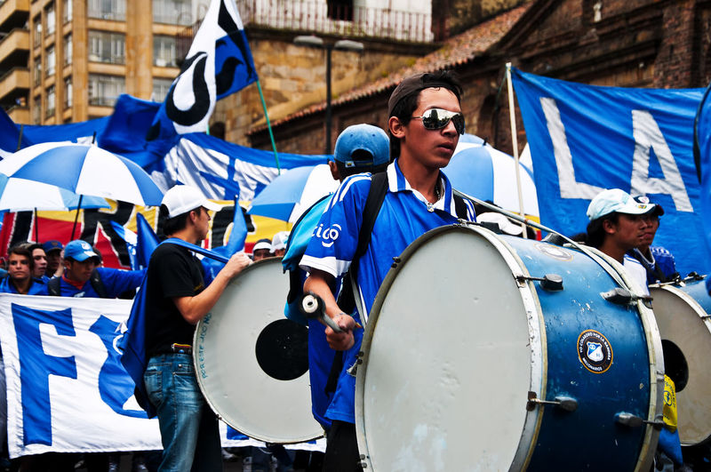 BOGOTA, COLOMBIA - JUNE 18: Fans of the Millonarios soccer team parade through the streets of Bogota, Colombia on June 18, 2011 Adult Blue Bogotá City Colombia Culture Cundinamarca Day Downtown Event Fan Fans Flag Football Millonarios New Outdoor Outdoors Parade People Pride Soccer Street Urban