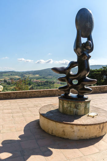 San Gimignano Tuscany Architecture Blue Built Structure Cloud - Sky Day Fountain Italy Metal Nature No People Outdoors Plant Sculpture Shadow Shape Sky Sunlight Tranquil Scene Tranquility Water