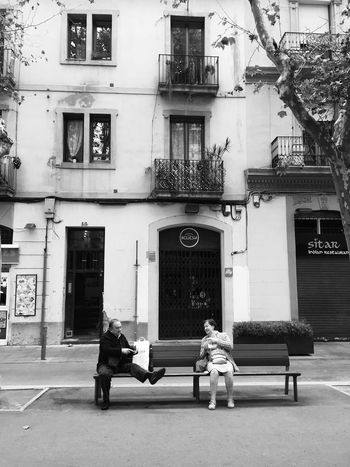 Xerrant Building Exterior Architecture Full Length Built Structure Outdoors Day Women Men Real People One Person People Street Photography Streetphotography Streetphoto_bw Blackandwhite Enjoying Life Talking Pictures Conversation Grandma Grandpa Grandparents City Barcelona Poblenou Discover Your City