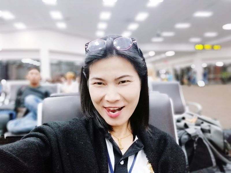 Ready to go... JiraOn🌏 Waiting Airport Terminal Airport Waiting EyeEm Selects City Airplane Portrait Business Travel Smiling Business Airport Departure Area Headshot Airport Journey Subway Platform Cabin Crew Subway Passenger Cabin Underpass Corporate Jet Subway Station Public Transportation