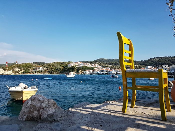 Greakenland Griechenland Samos Greece Chair Yellow Chair GREECE ♥♥ Sunny Day Habour Wood - Material Sky Horizon Over Water Scenics