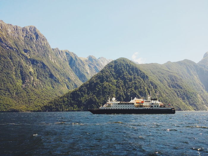 Cruise Ship Against Mountains At Milford Sound