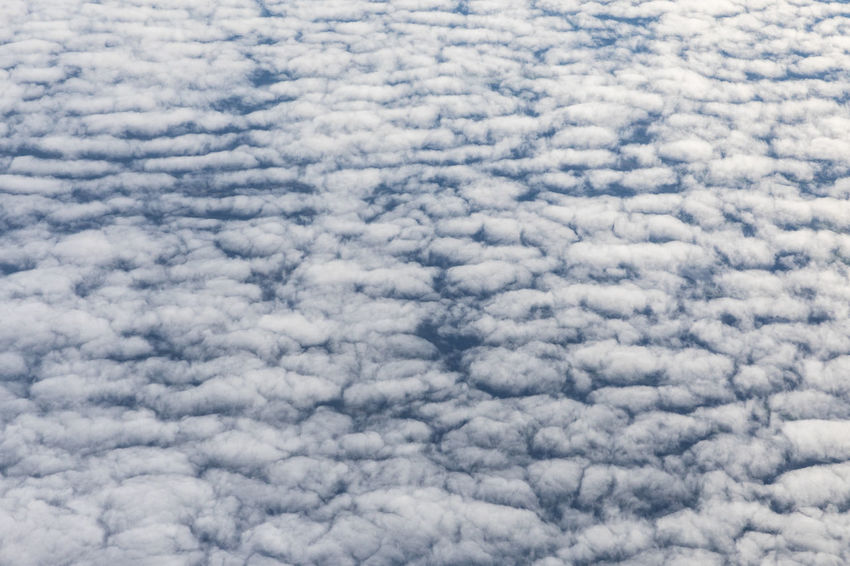 Full frame shot of cirrocumulus clouds seen from above Copy Space Natural Pattern Weather Aerial View Backgrounds Beauty In Nature Cirrocumulus Close-up Cloud - Sky Cloudscape Cumulus Cloud Day Directly Above Fluffy Flying Full Frame High Angle View Nature No People Outdoors Pattern Sky Sky Only Textured  White Color