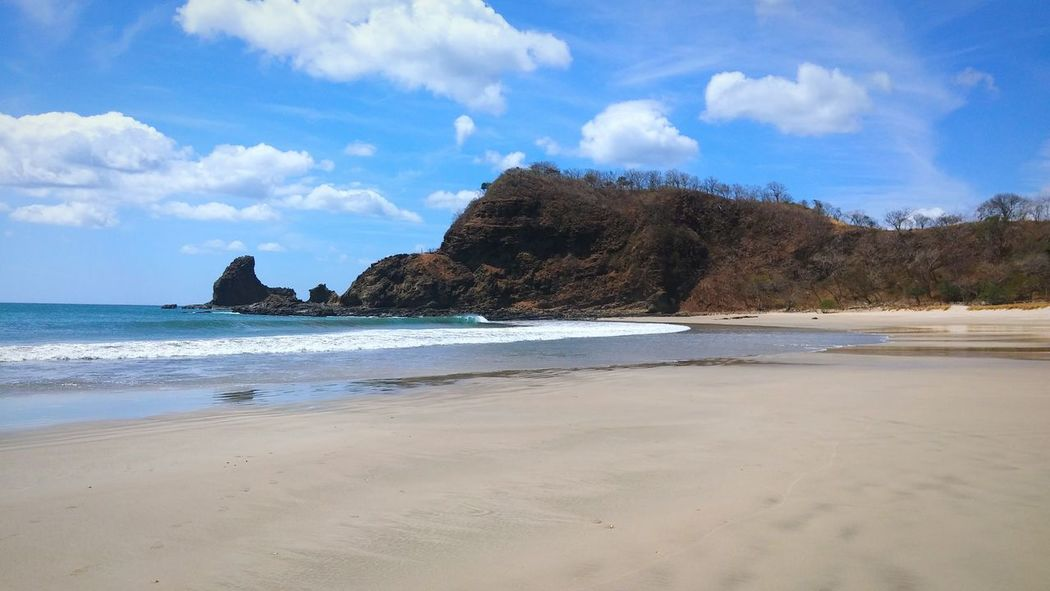 Nicaragua, Playa Maderas (2016) Nicaragua Beach Pacific Ocean Sand Landscape Coastline Cloud - Sky Travel Destinations Water Coastal Feature Tide Outdoors No People Day Nature Wave Travel Photography Scenics EyeEm Best Shots Beauty In NatureTranquility Pacific Beach Life Is A Beach Lifestyles Traveling