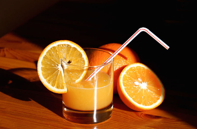 Close-up of orange drink in glass on table