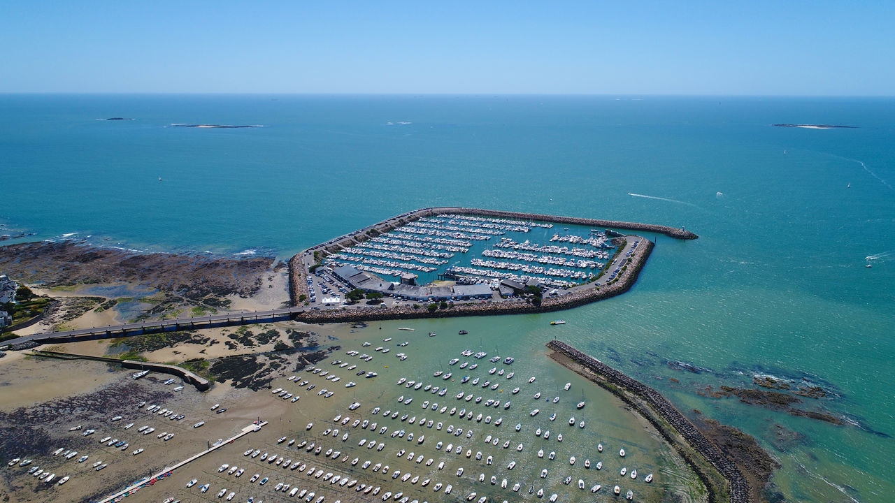 sea, water, horizon over water, high angle view, transportation, day, scenics, nautical vessel, aerial view, nature, no people, outdoors, beauty in nature, freight transportation, sky