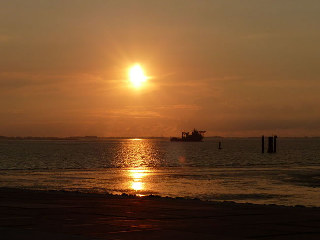Water Nautical Vessel Sea Oil Pump Sunset Beach Sailing Silhouette Sun Reflection Seascape Low Tide Horizon Over Water Fishing Boat Trawler Fishing Industry Wave Coastline Dramatic Sky Jet Boat Ship Coast Ocean Coastal Feature