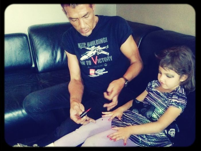My brother Robbie paintinf his lil lady's nails.