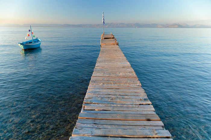Corfu, Greece Beauty In Nature Day Greece Jetty Little Boat Nature No People Outdoors Pier Scenics Sea Sky Sunset The Way Forward Tranquil Scene Tranquility Water Wood - Material