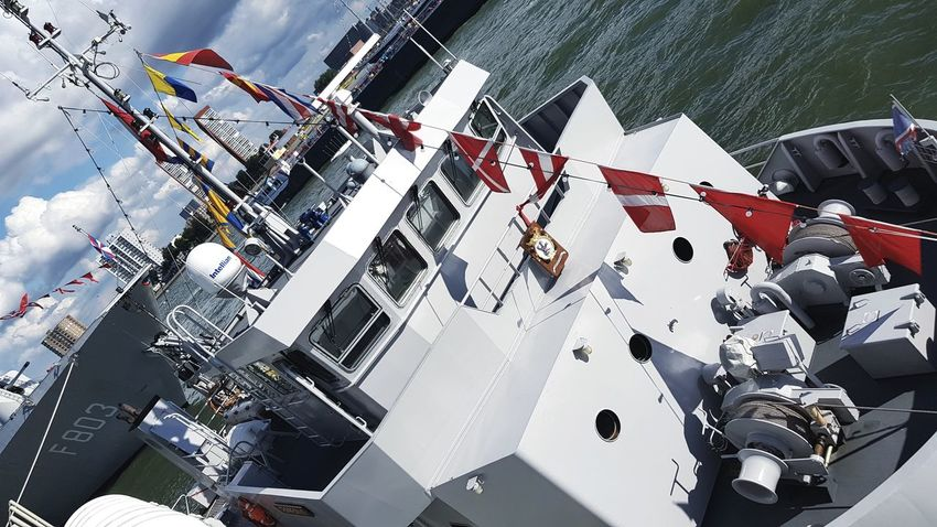 No People Outdoors Boats And Water Nautical Vessel Eye4photography  Taking Photos Taking Pictures Flags In The Wind  Flag Riverside River Ship Wereldhavendagen Ships⚓️⛵️🚢 Ships Boats Warfare War Ship Marine Marine Life Army Technology Mode Of Transport Transportation Docked
