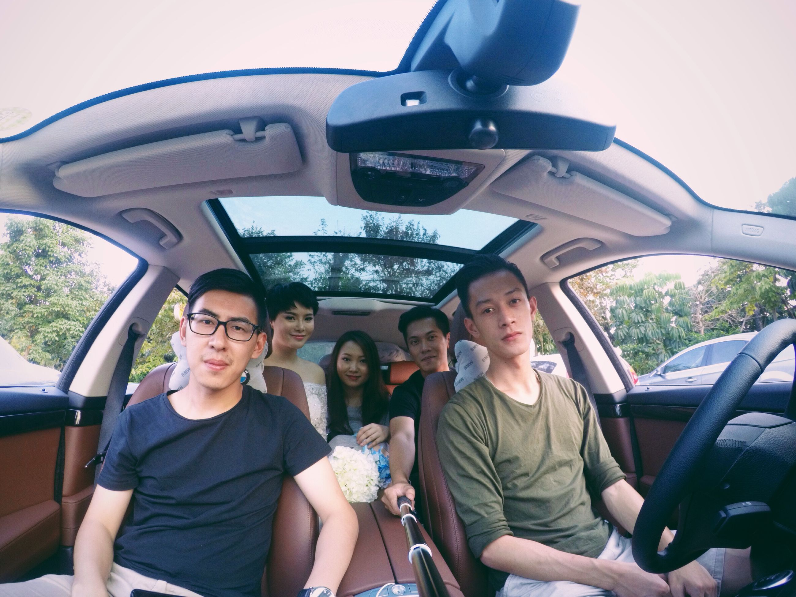 transportation, mode of transport, lifestyles, leisure activity, young adult, travel, land vehicle, casual clothing, person, young men, sitting, vehicle interior, car, men, togetherness, looking at camera, smiling