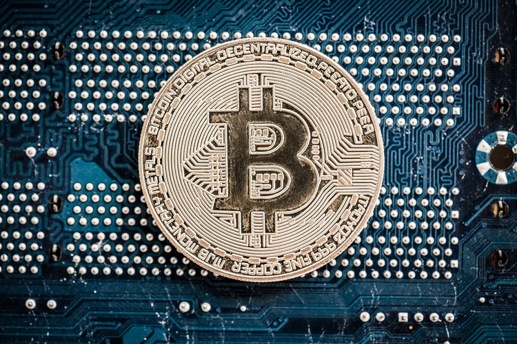 Close-up of bitcoin on circuit board
