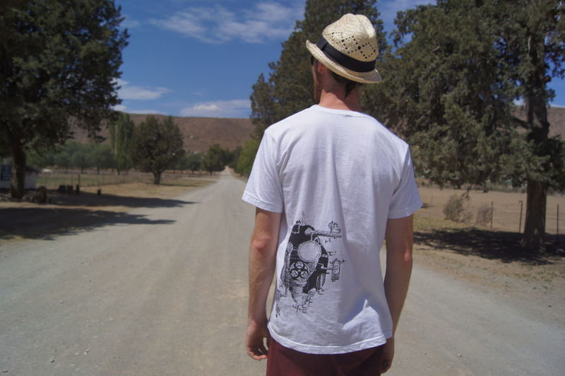 Taking a stroll along the dirt roads of a little Karoo village. Nieu Bethesday South Africa Nieu Bethesda South Africa Casual Clothing Hat Klein Karoo One Person Outdoors Real People Rear View Road Walking