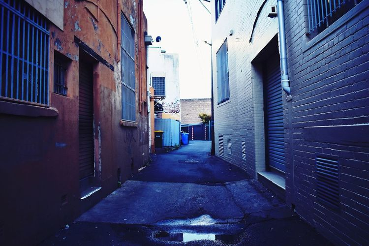 Blue street Photography EyeEm Gallery EyeEm Picoftheday Outdoors Brickwall Blue Building Exterior Architecture Built Structure City Building The Way Forward Direction Residential District Street Day Real People Alley Narrow Footpath Sky Diminishing Perspective Men Nature Outdoors Two People