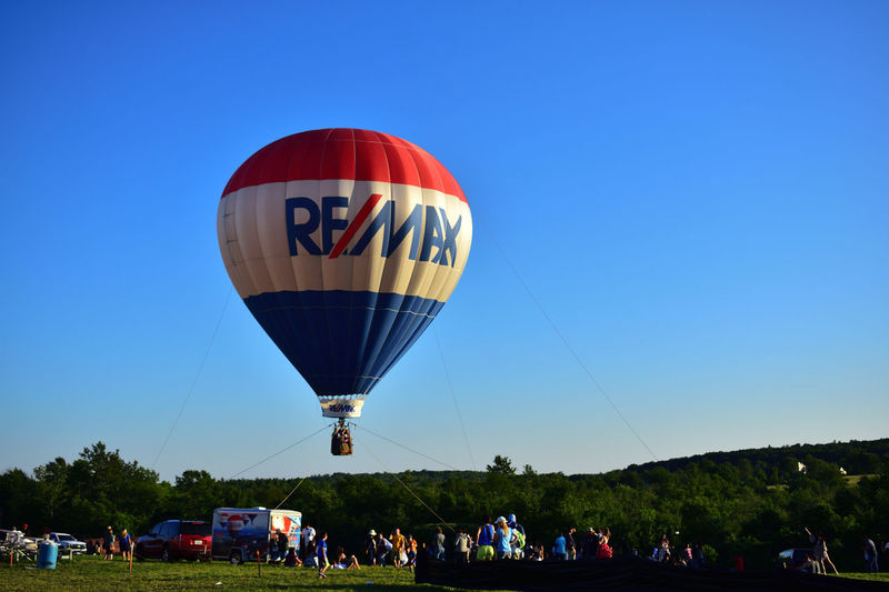 New England Balloon Festival Hot Air Balloon Large Group Of People Leisure Activity Ballooning Festival Fun Multi Colored Adventure Mid-air People Crowd Event Flying Excitement Tree Air Vehicle Togetherness Enjoyment Sky Blue Day