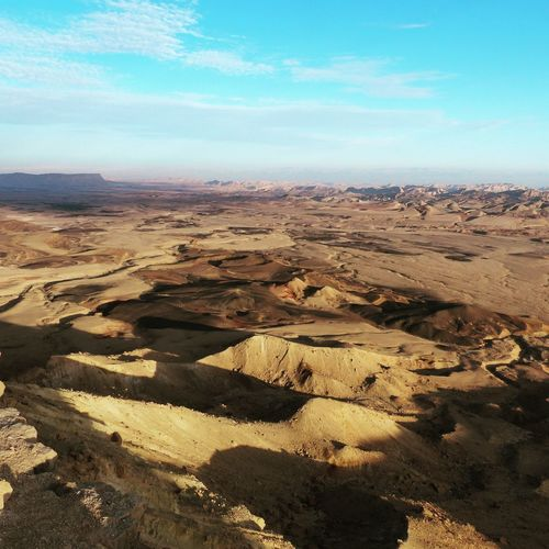 The Ramon Crater in Israel's Negev Desert is the world's largest erosion crater, or makhtesh – landform unique to Israel's Negev and Egypt's Sinai desert. Israel Ramon Crater Landscape Scenics Arid Climate Outdoors Nature Desert Sand Dune Sand Day No People Beauty In Nature View Into Land Sky