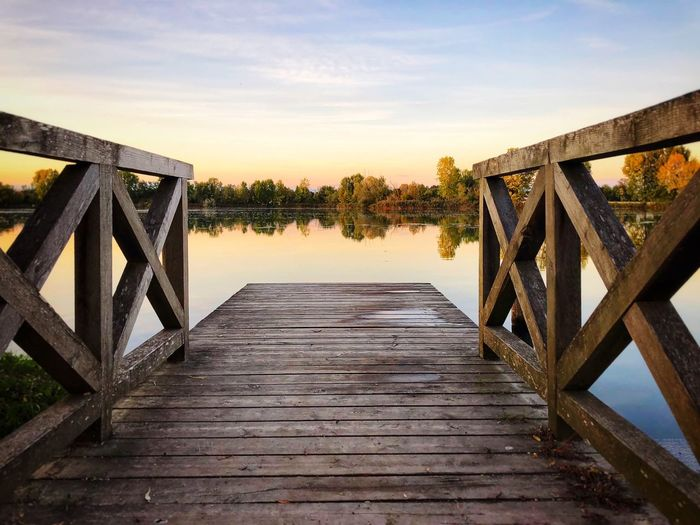 Lake Treviso Water Sky Bridge The Way Forward Railing Connection Direction Built Structure Bridge - Man Made Structure Nature No People Tranquil Scene Tranquility River Wood - Material Cloud - Sky Tree Pier Diminishing Perspective