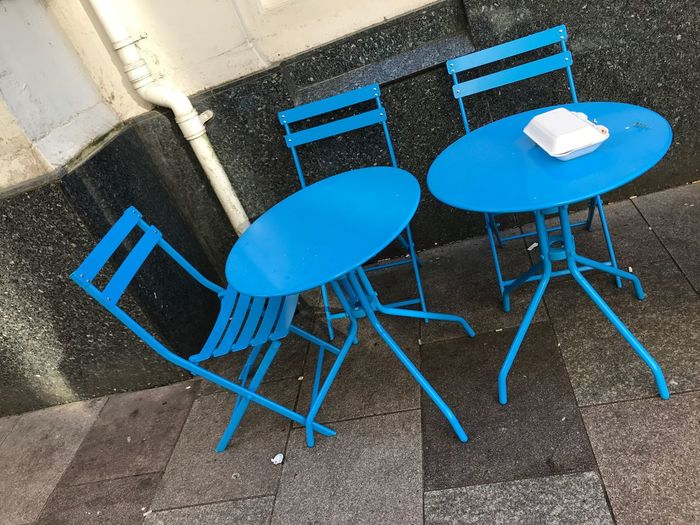 Chairs And Table Chairs City Wales Street Photography Urban Street EyeEm Selects Seat Blue Chair Absence No People Table Cafe Day Empty Business Wall - Building Feature Furniture Built Structure Architecture Outdoors