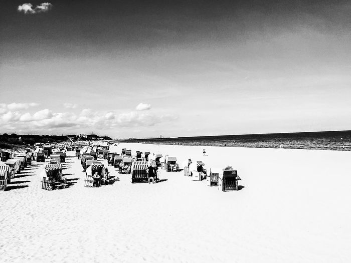 Ahlbeck Beach in B&W EyeEm Best Shots - Black + White Blackandwhite EyeEm Nature Lover EyeEm Best Shots - Nature EyeEmBestPics Sky Day Nature Water Scenics - Nature Beauty In Nature Tranquility Tranquil Scene No People Outdoors Land Copy Space Non-urban Scene Clear Sky Text Environment Animal Vertebrate Flock Of Birds
