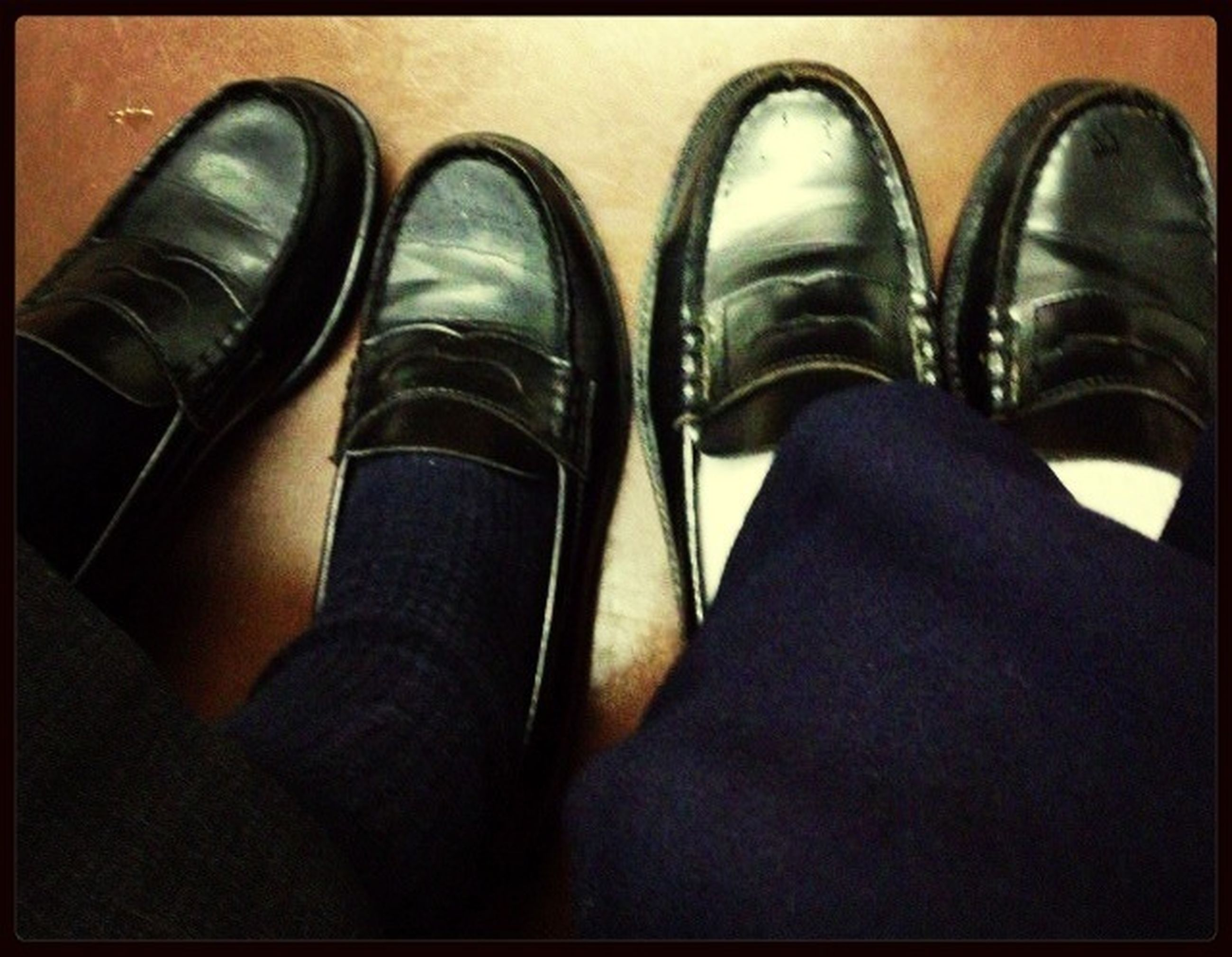 shoe, low section, person, indoors, personal perspective, close-up, fashion, footwear, high angle view, auto post production filter, pair, part of, still life, black color, canvas shoe, side by side, human foot
