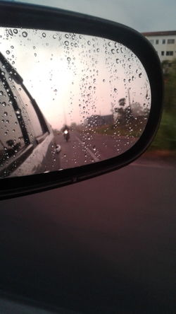 Drop Glass - Material Wet Water Reflection Rain Window Transportation RainDrop Close-up Rainy Season Indoors  No People Day Vehicle Mirror