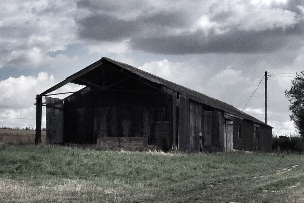 sky, abandoned, architecture, built structure, grass, field, building exterior, cloud - sky, no people, outdoors, landscape, day, desolate, nature