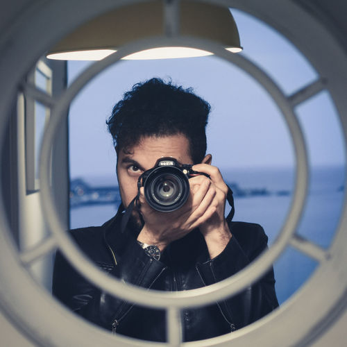 Portrait of man photographing