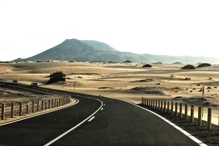 Empty road leading towards mountains
