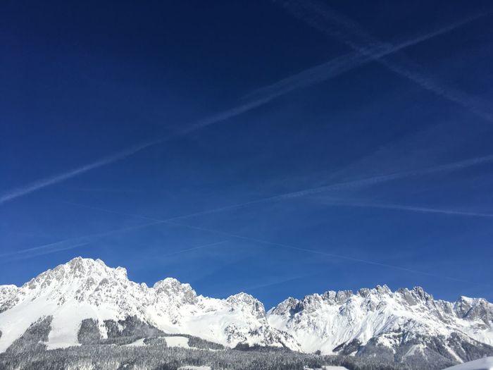 Climbing Skiing Tyrol Wilder Kaiser Snow Winter Cold Temperature Mountain Sky Blue Beauty In Nature Mountain Range Vapor Trail Idyllic Snowcapped Mountain