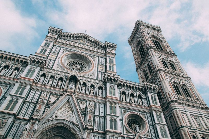 Low angle view of temple building against sky - santa maria del fiore, florence