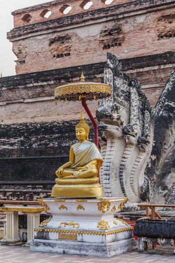 Buddha statue against temple