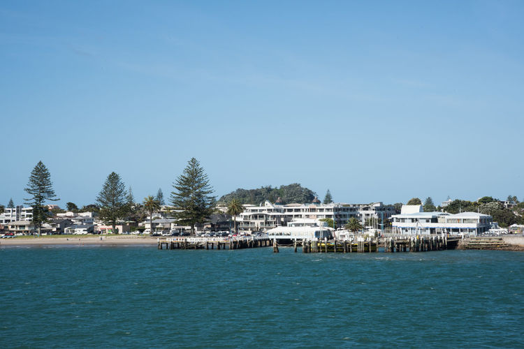 Tauranga, North Island/New Zealand-December 16,2016: Waterfront piers, tourists and architecture in Tauranga, New Zealand Pier Tauranga Tourists Vacations Apartments Architecture Building Building Exterior Clear Sky Condominium Copy Space Development Housing Jetty Nature New Zealand Pacific Ocean Parking People Residential District Sea Swimsuit View Into Land Water Waterfront