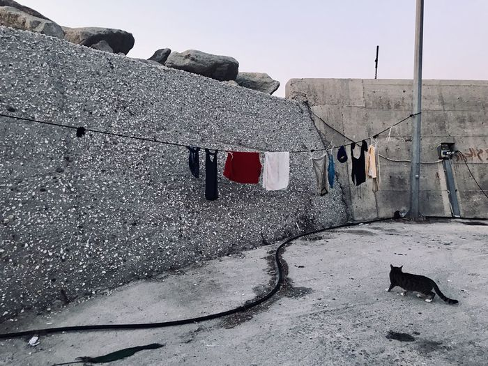 Clothes drying on the wall