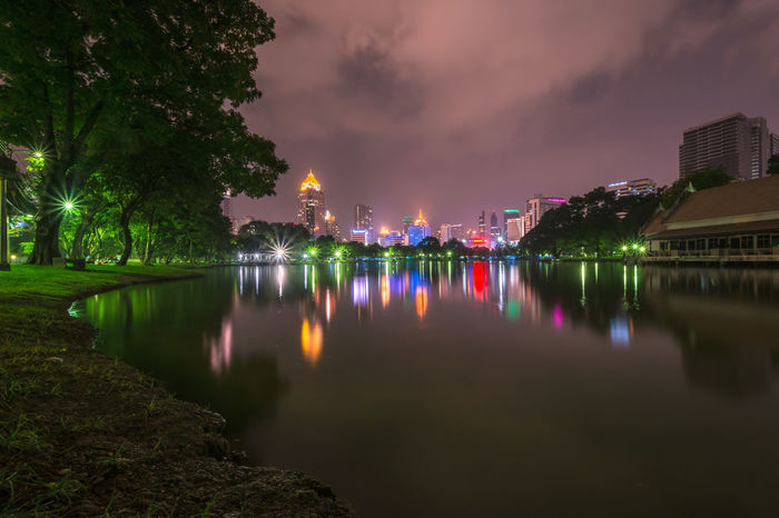 Soft focus night and raincloud, view of downtown at Lumphini Park in Bangkok, Thailand Architecture Beauty In Nature Built Structure City Cloud Cloud - Sky Cloudy Growth Idyllic Illuminated Lumphini Park Multi Colored Nature No People Outdoors Overcast Reflection Scenics Sky Standing Water Tranquil Scene Tranquility Tree Water Weather