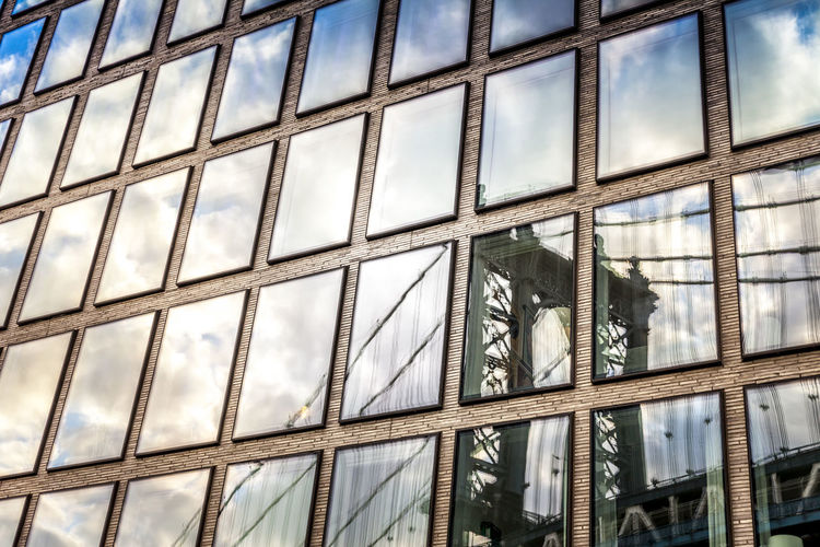 Bridge / Sky Reflection on Building Windows Brooklyn Manhattan NYC New York New York City Rectangles Reflection Architecture Blue Building Building Windows Close-up Clouds Day Full Frame Low Angle View Manhattan Bridge No People Reflections Sky Squares White Window Windows Wires