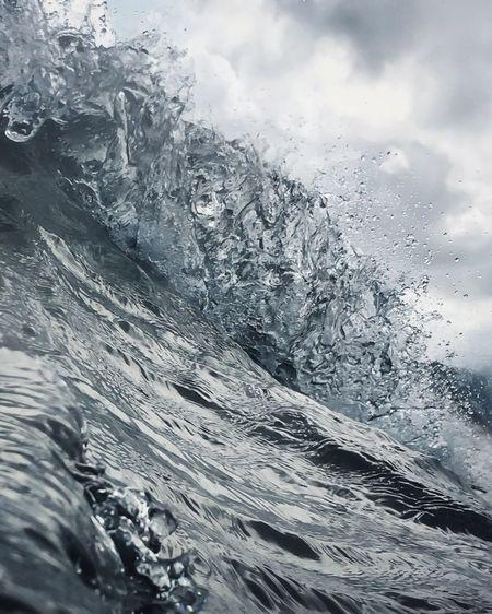 Full frame shot of frozen sea against sky