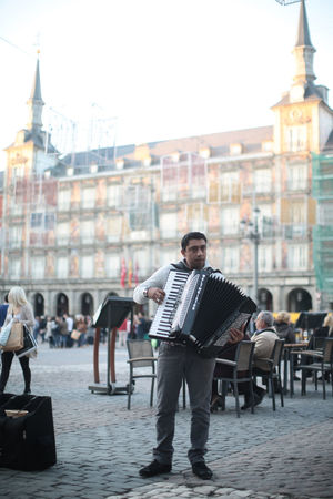 An accordion player in the Plaza Mayor of Madrid, Spain Accordion Acordeón City Life Lifestyles Mayor Plants Real People Spain, Madrid, Tourism, Tourist, Buildings Tradition