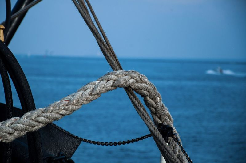 Close-up of rope against sea