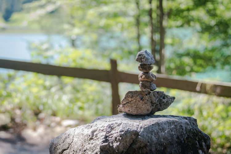 Stone Pile Stone Pile Solid Focus On Foreground Rock Rock - Object Nature No People Day Tree Plant Balance Stack Outdoors Stone - Object Close-up Sunlight Selective Focus Textured  Metal Zen-like Railing