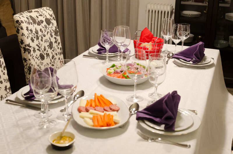 Festive table NapkinFolding Napkins Salad Arrangement Carrots Dining Table Drinking Glass Food Food And Drink Indoors  Meal Mustard Napkin No People Place Setting Plate Purple Ready-to-eat Table Tablecloth Wineglass